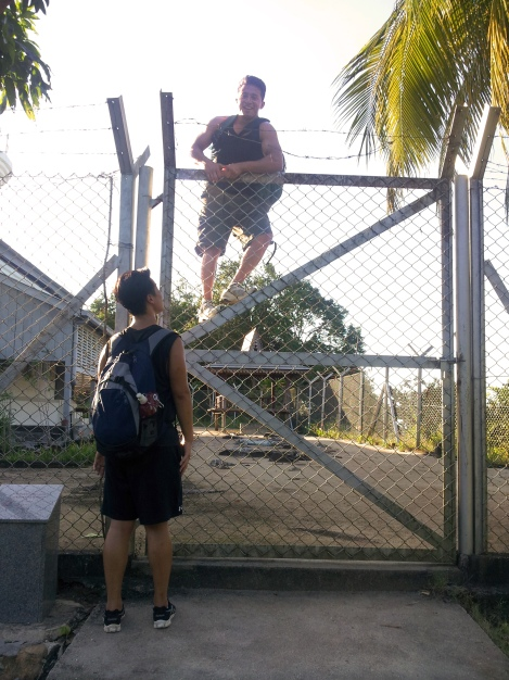 Sam climbing over the fence when we got to the lighthouse. A guard came to kick us out after :(
