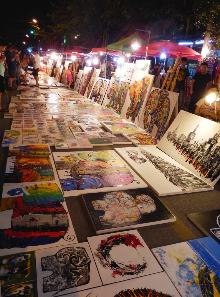 Paintings being sold in the Sunday Market. Tons of great food and the artwork isn't all too bad.