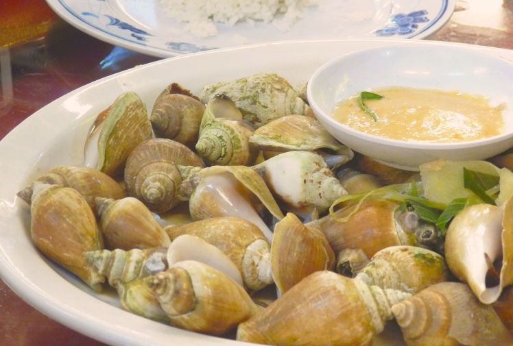 These shells were cooked in rice wine I believe. Use a toothpick to fish out the chewy morsels of meat!