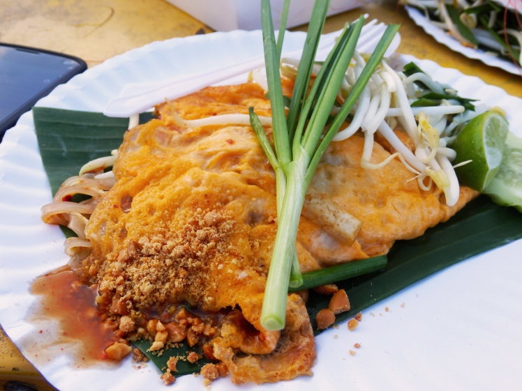 Delicious fried noodles inside an omelette