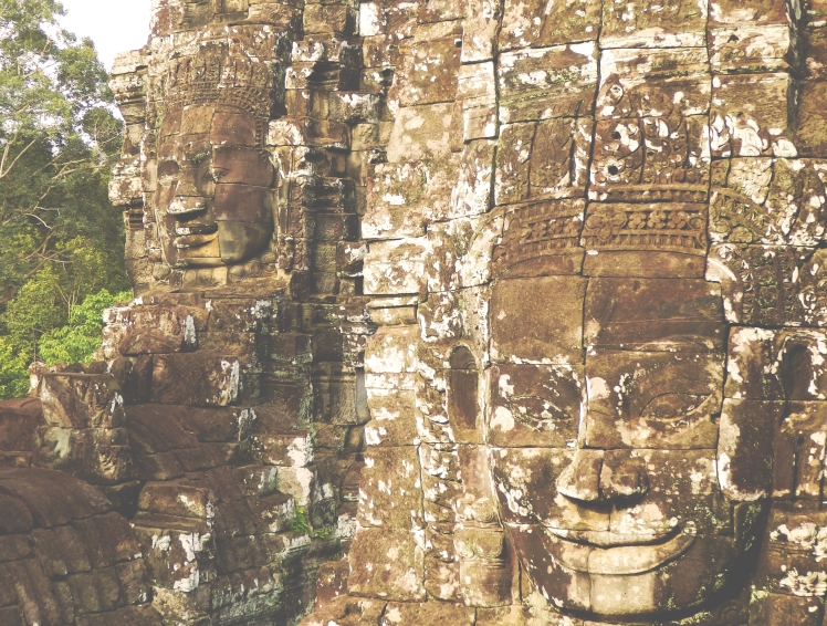Giant head sculptures in the Angkor complex